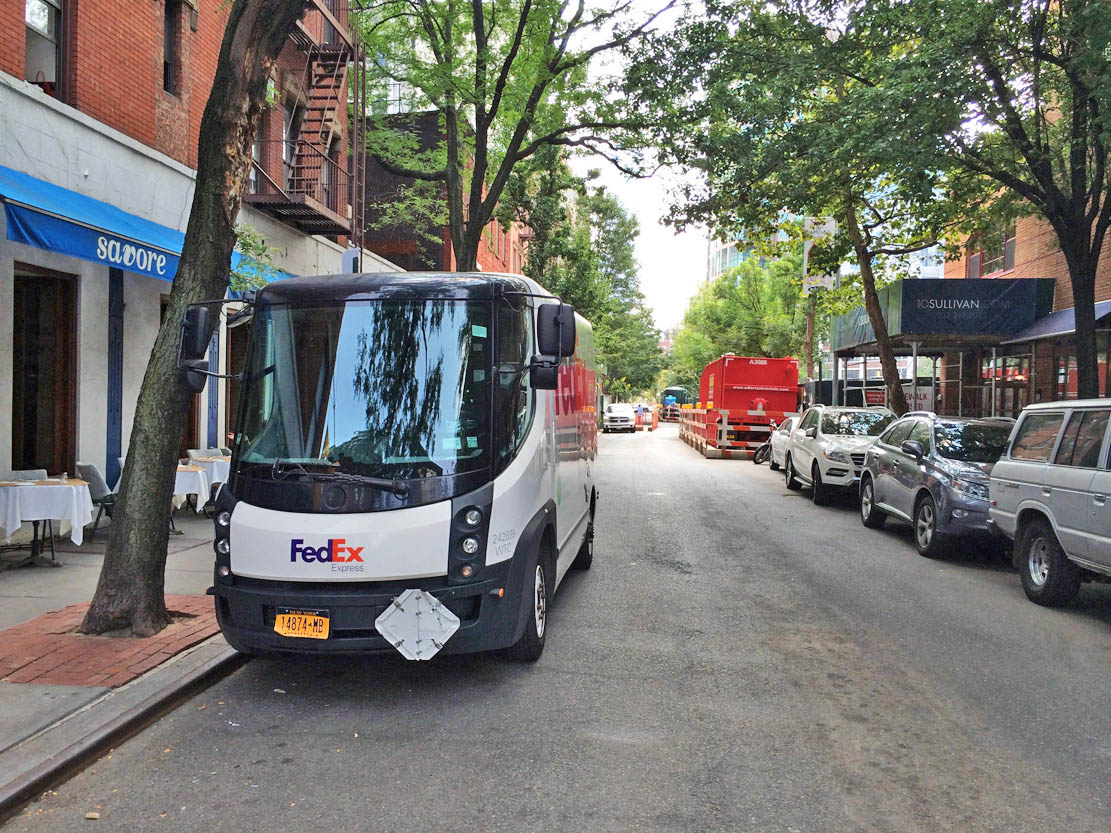 A narrow, electric FedEx truck in SoHo, August 2014