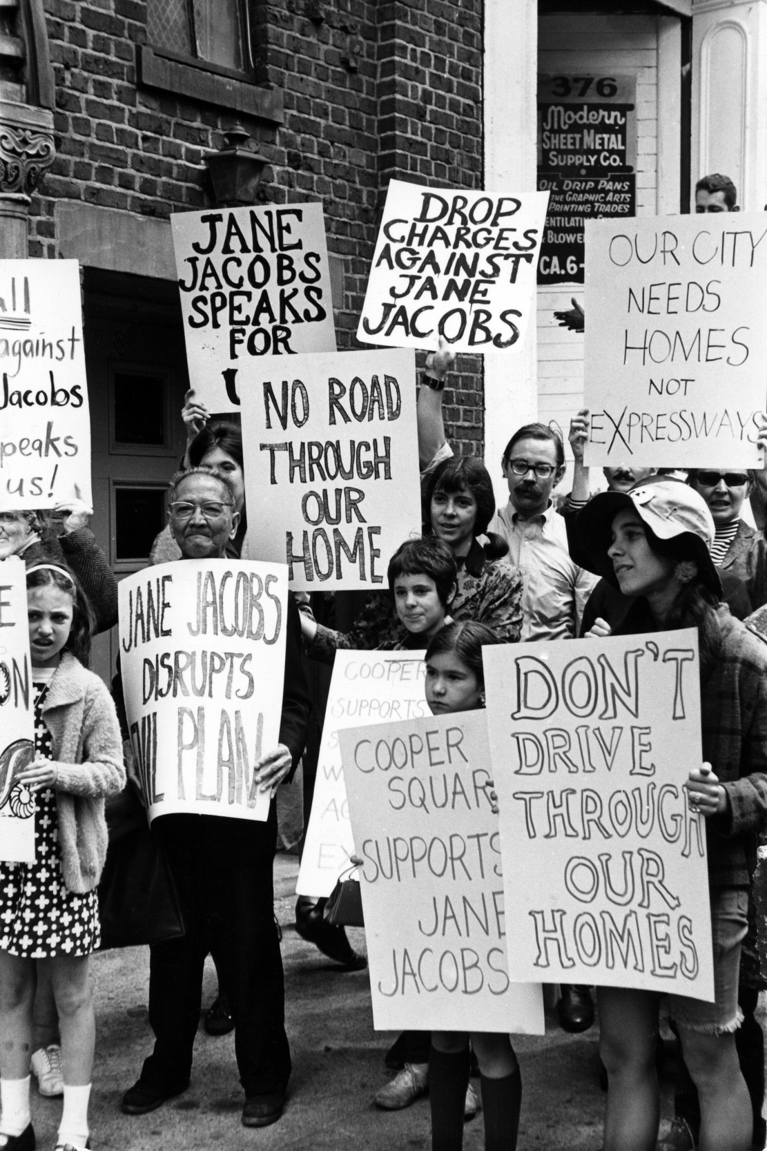 Demonstrators protest charges against activist & author Jane Jacobs (not pictured), New York, New York, May 8, 1968. The then 51-year-old Jacobs had been arrested and charged with inciting riot at a protest of the propsed Lower Manhattan Expressway.